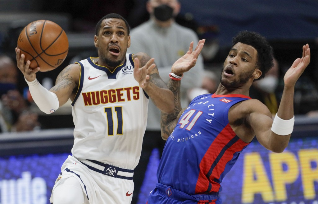 Denver Nuggets guard Monte Morris (11) drives to the basket against Detroit Pistons forward Saddiq Bey (41) in the second quarter of an NBA basketball...