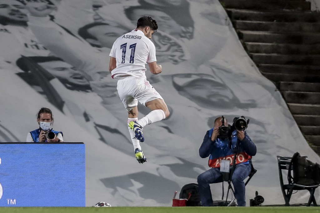 Real Madrid's Marco Asensio celebrates after scoring his team second goal during the Champions League quarterfinal first leg, soccer match between Rea...