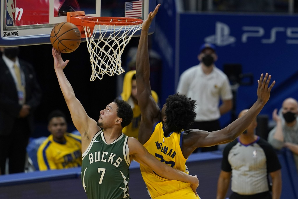 Milwaukee Bucks guard Bryn Forbes (7) shoots Golden State Warriors center James Wiseman during the first half of an NBA basketball game in San Francis...
