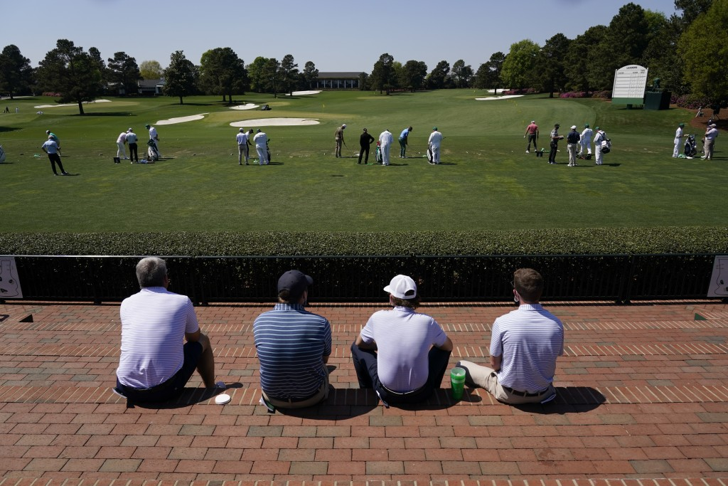 Patrons watch players warm up on the range before a practice round for the Masters golf tournament on Tuesday, April 6, 2021, in Augusta, Ga. (AP Phot...