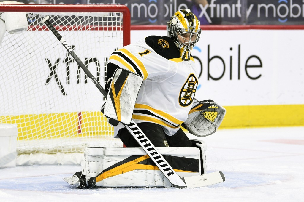 Boston Bruins goaltender Jeremy Swayman makes pad save on a shot during the first period of an NHL hockey game against the Philadelphia Flyers, Tuesda...