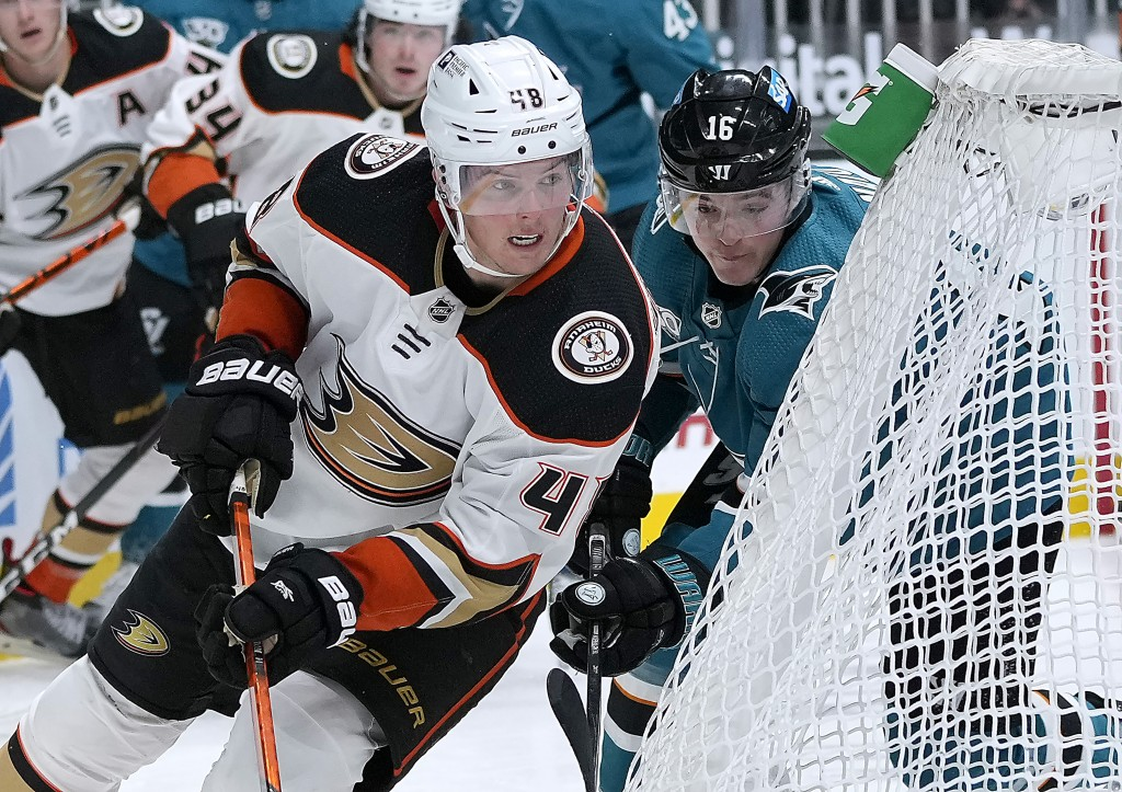 San Jose Sharks center Ryan Donato (16) chases Anaheim Ducks center Isac Lundestrom (48) during the third period of an NHL hockey game Tuesday, April ...