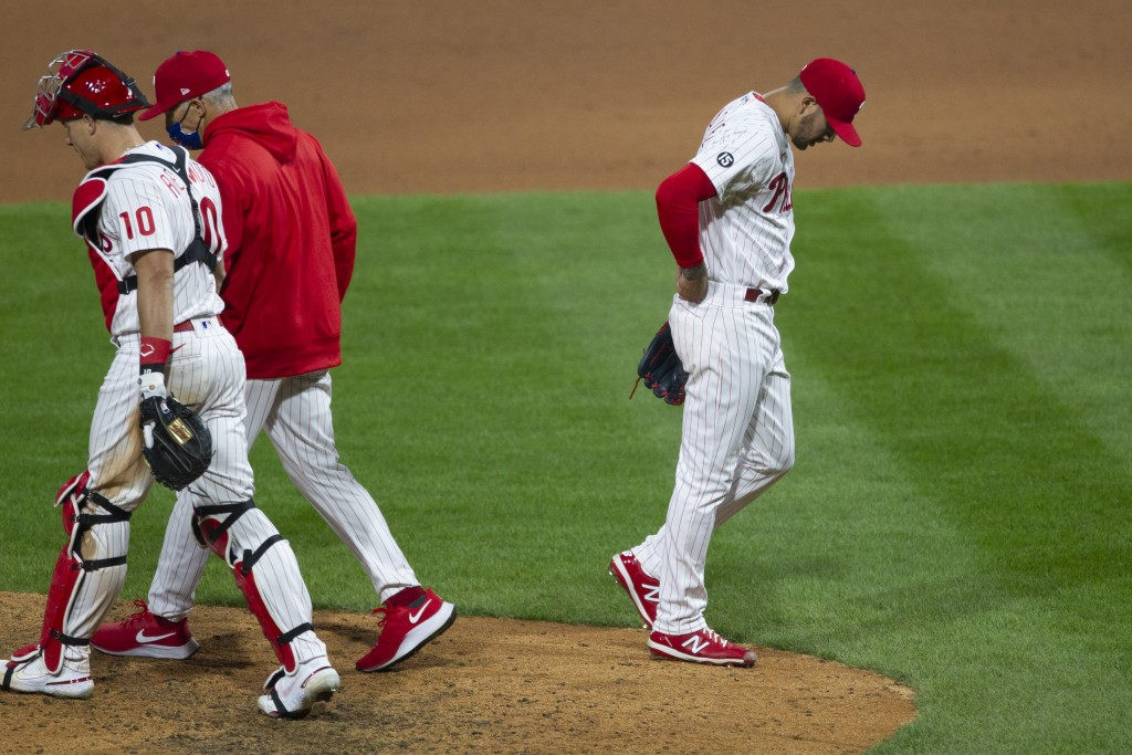 Philadelphia Phillies pitcher Vince Velasquez (21) walks off the mound after walking New York Mets Brandon Nimmo allowing Luis Guillorme to score duri...