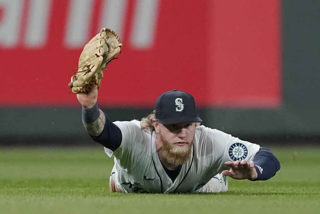 Seattle Mariners left fielder Jake Fraley makes a diving catch for an out on a line drive hit by Chicago White Sox's Yoan Moncada during the fifth inn...