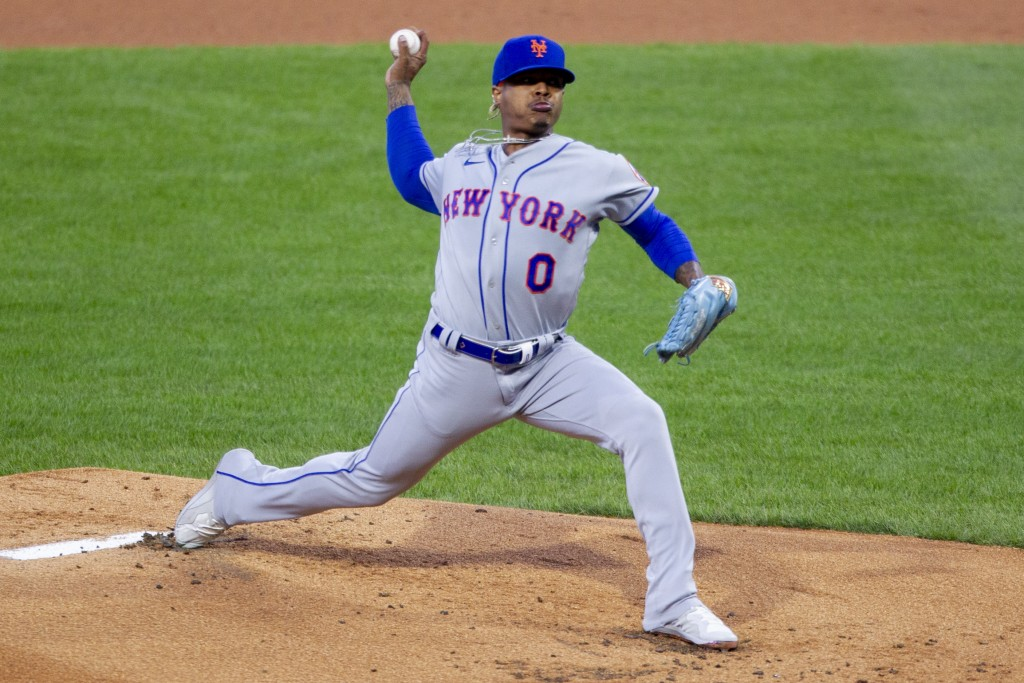New York Mets starting pitcher Marcus Stroman (0) throws during the first inning of a baseball game against the Philadelphia Phillies, Tuesday, April ...