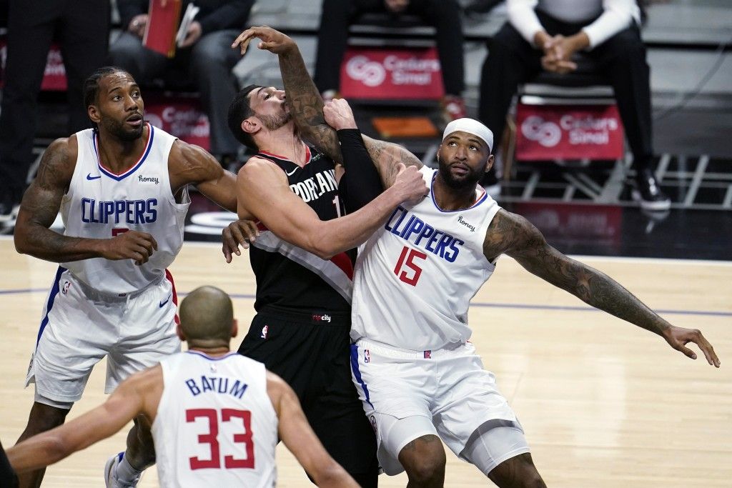 Los Angeles Clippers center DeMarcus Cousins (15) works for position under the basket next to Portland Trail Blazers center Enes Kanter, center, and C...