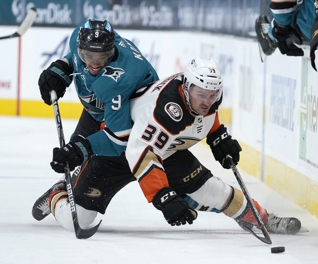 San Jose Sharks left wing Evander Kane (9) vies for the puck against Anaheim Ducks center Sam Carrick (39) during the second period of an NHL hockey g...
