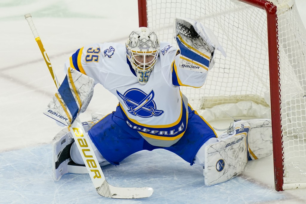 Buffalo Sabres goaltender Michael Houser makes a save during the second period of the team's NHL hockey game against the New Jersey Devils, Tuesday, A...
