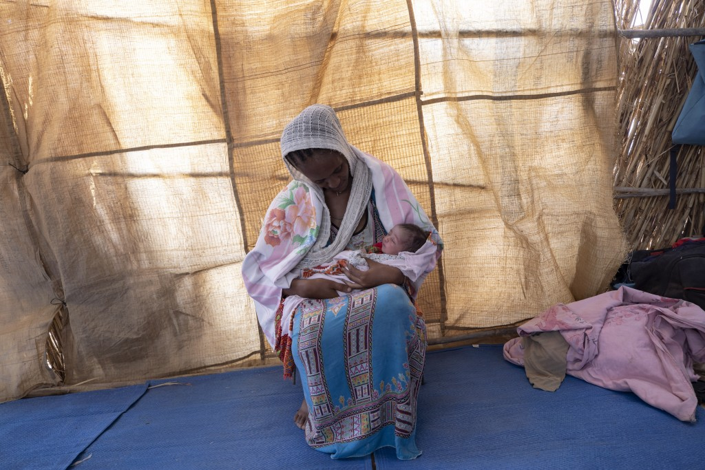 Lemlem Gebrehiwet, a 20-year-old Tigrayan refugee, holds her 3-day-old daughter, Semhal, in their shelter in Hamdayet, eastern Sudan, near the border ...