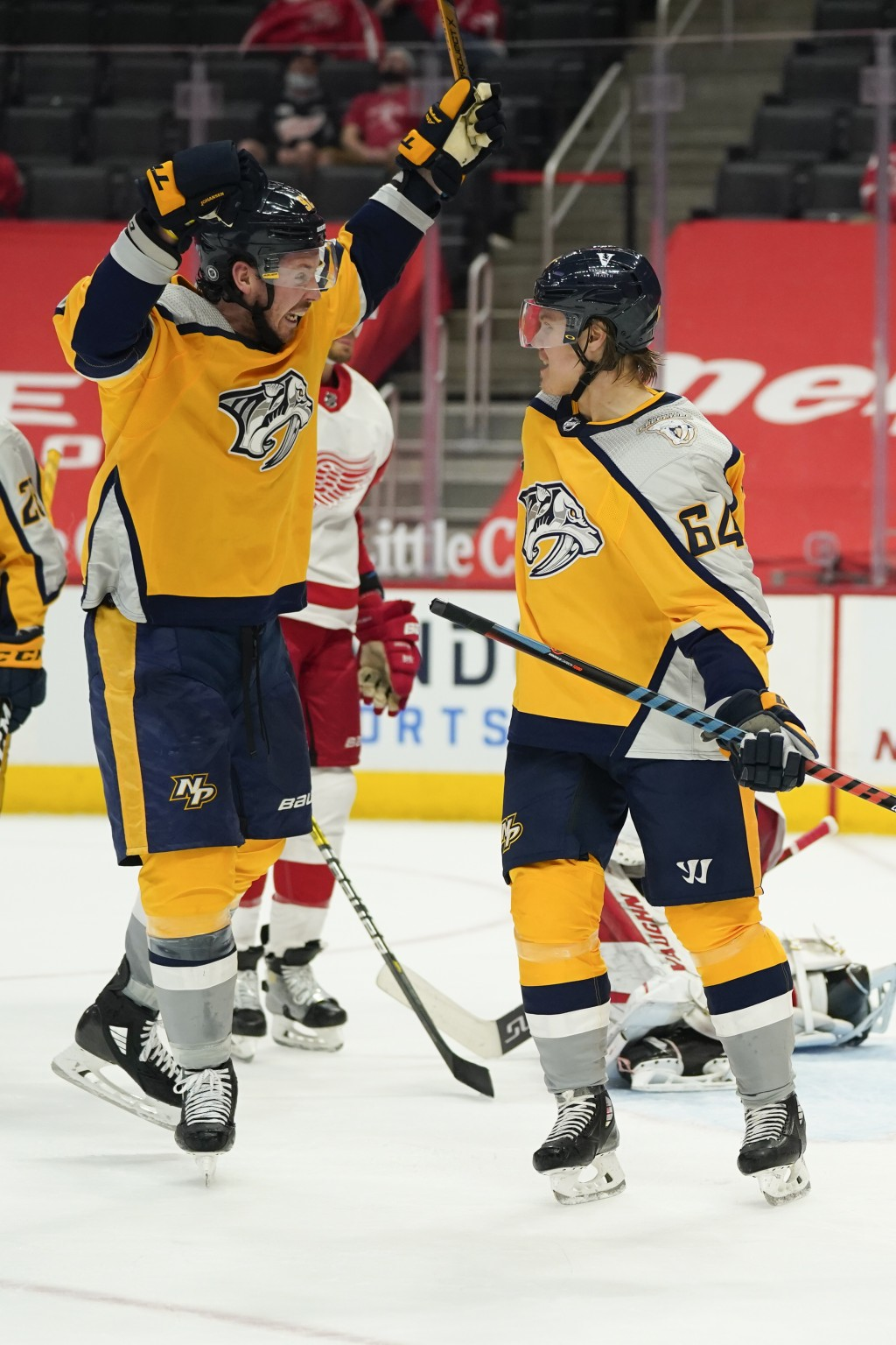 Nashville Predators center Mikael Granlund, right, celebrates his goal with Ryan Johansen in the third period of an NHL hockey game against the Detroi...
