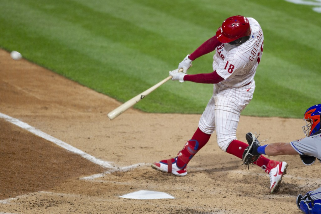 Philadelphia Phillies Didi Gregorius (18) hits a home run during the fourth inning of a baseball game against the New York Mets, Tuesday, April 6, 202...