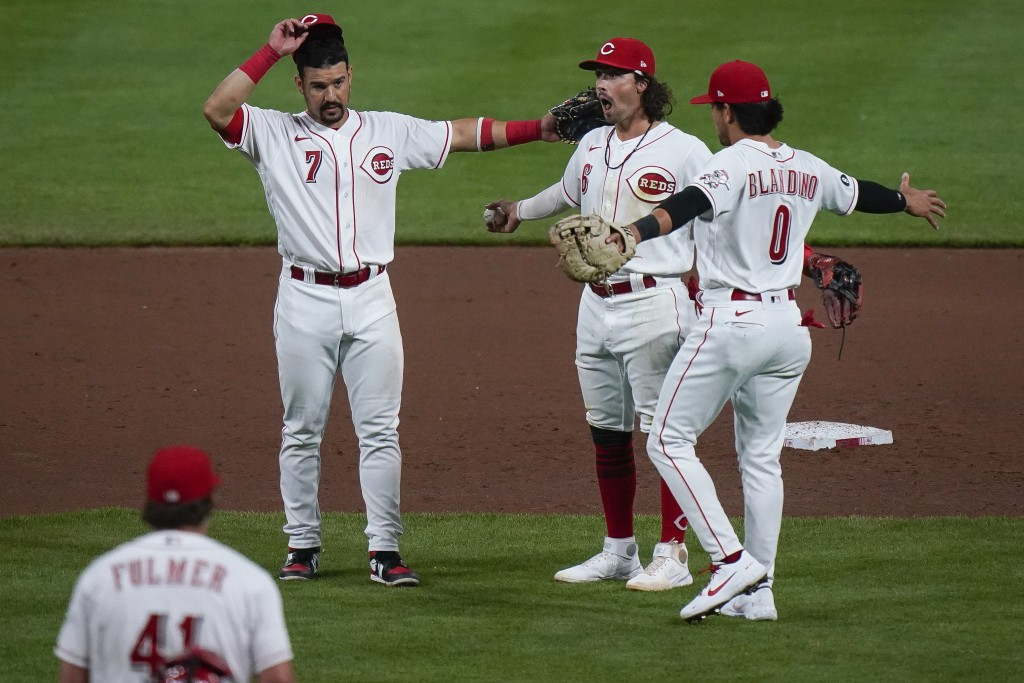 Cincinnati Reds' Jonathan India, center, celebrates with teammates Alex Blandino, right, and Eugenio Suarez, left, after defeating the Pittsburgh Pira...