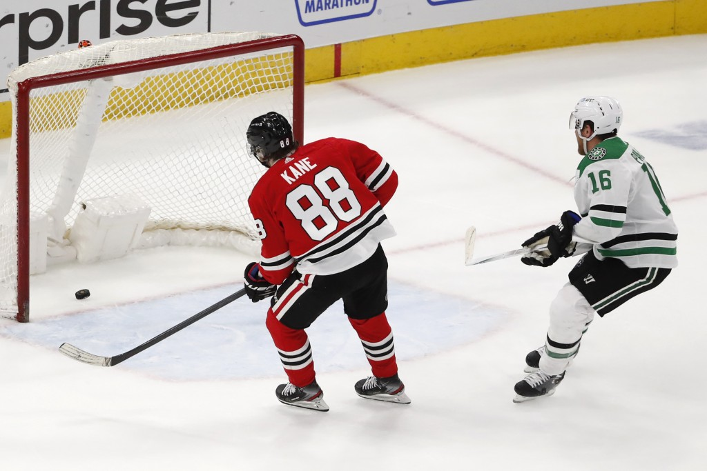 Chicago Blackhawks right wing Patrick Kane (88) scores an empty net goal as Dallas Stars center Joe Pavelski (16) looks on during the third period of ...
