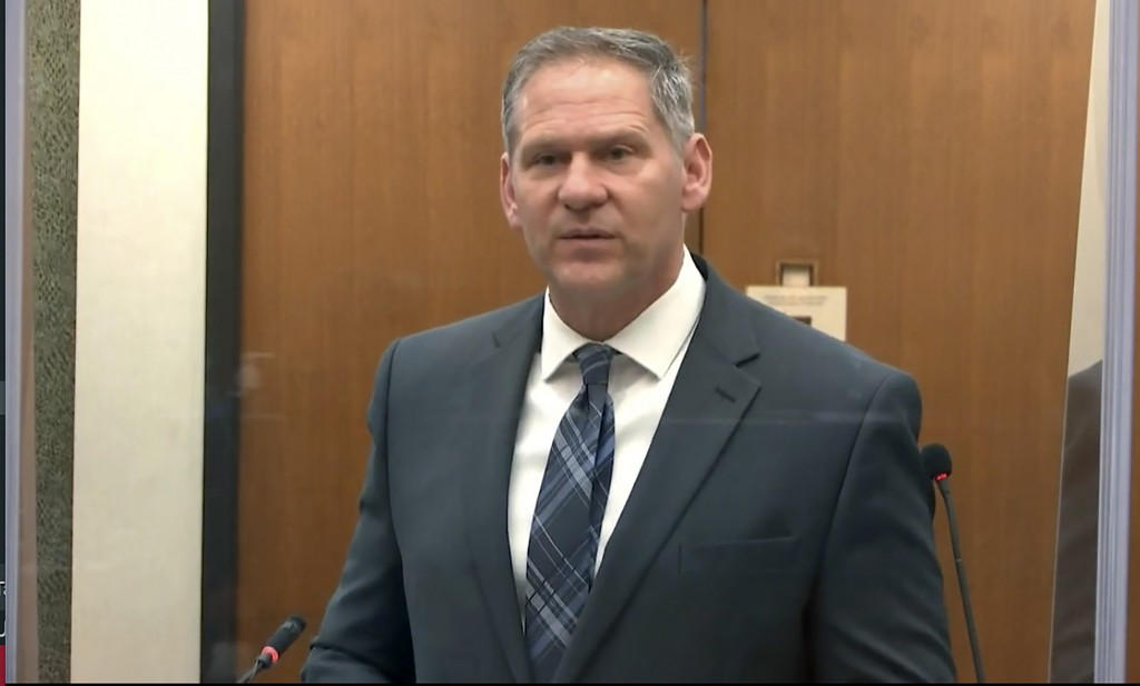 In this image from video, prosecutor Steve Schleicher questions Minneapolis Police Crisis Intervention Coordinator Ker Yang as Hennepin County Judge P...