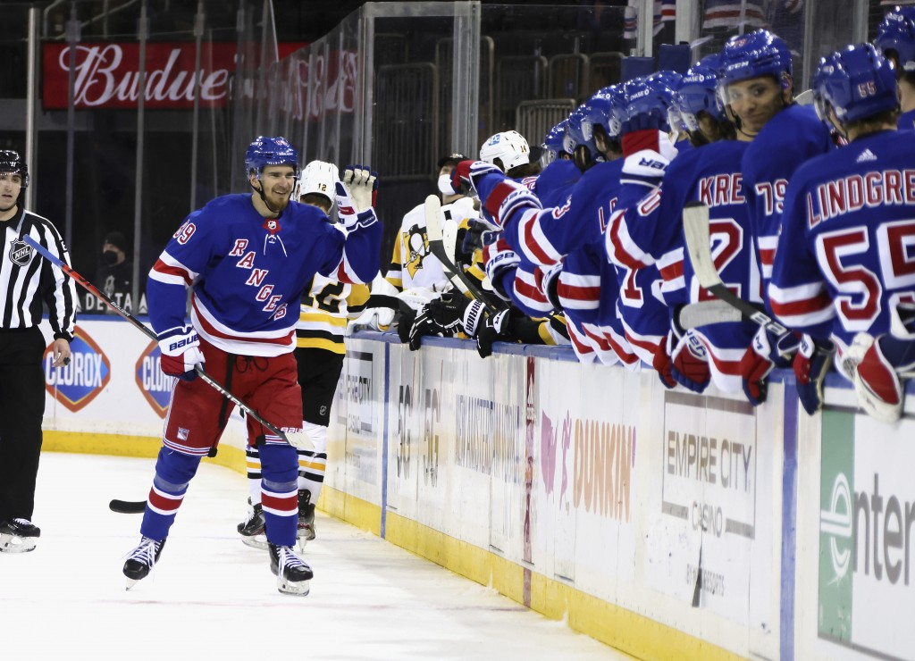 New York Rangers' Pavel Buchnevich (89)celebrates his goal against the Pittsburgh Penguins during the third period of an NHL hockey game Tuesday, Apri...