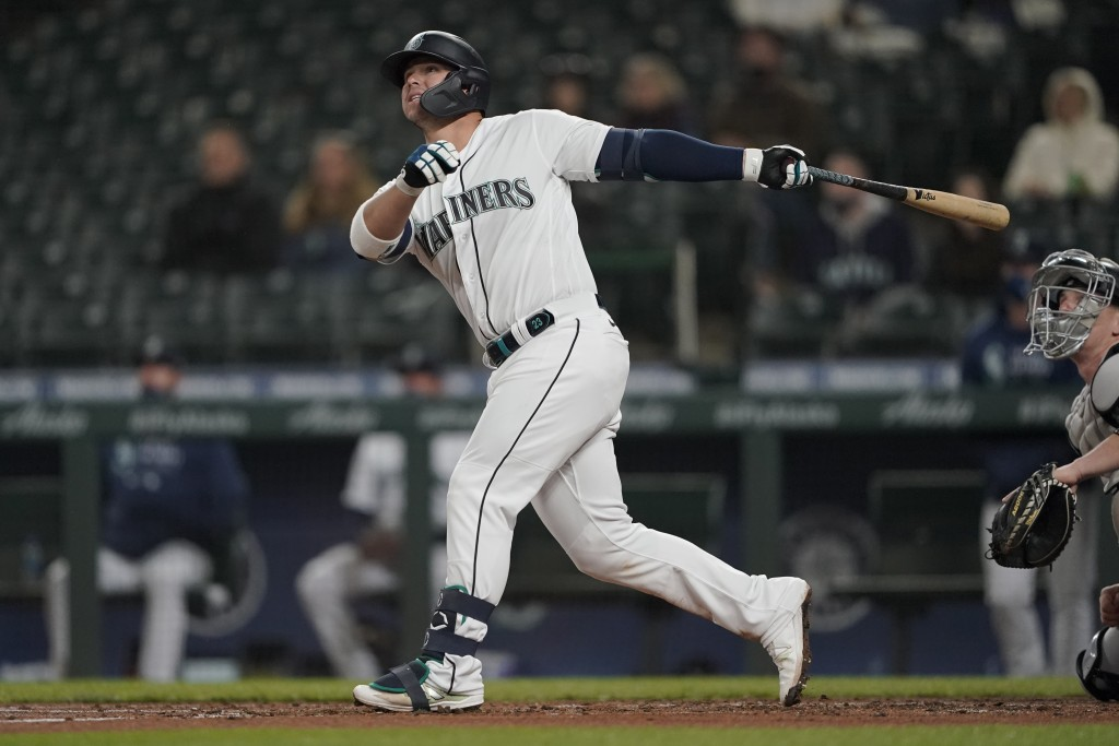 Seattle Mariners' Ty France watches his RBI double during the third inning of the team's baseball game against the Chicago White Sox, Tuesday, April 6...