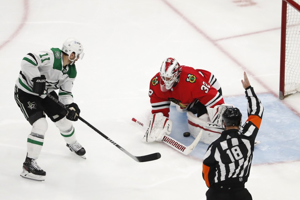 Dallas Stars center Andrew Cogliano (11) scores a short handed goal past Chicago Blackhawks goaltender Kevin Lankinen (32) during the third period of ...