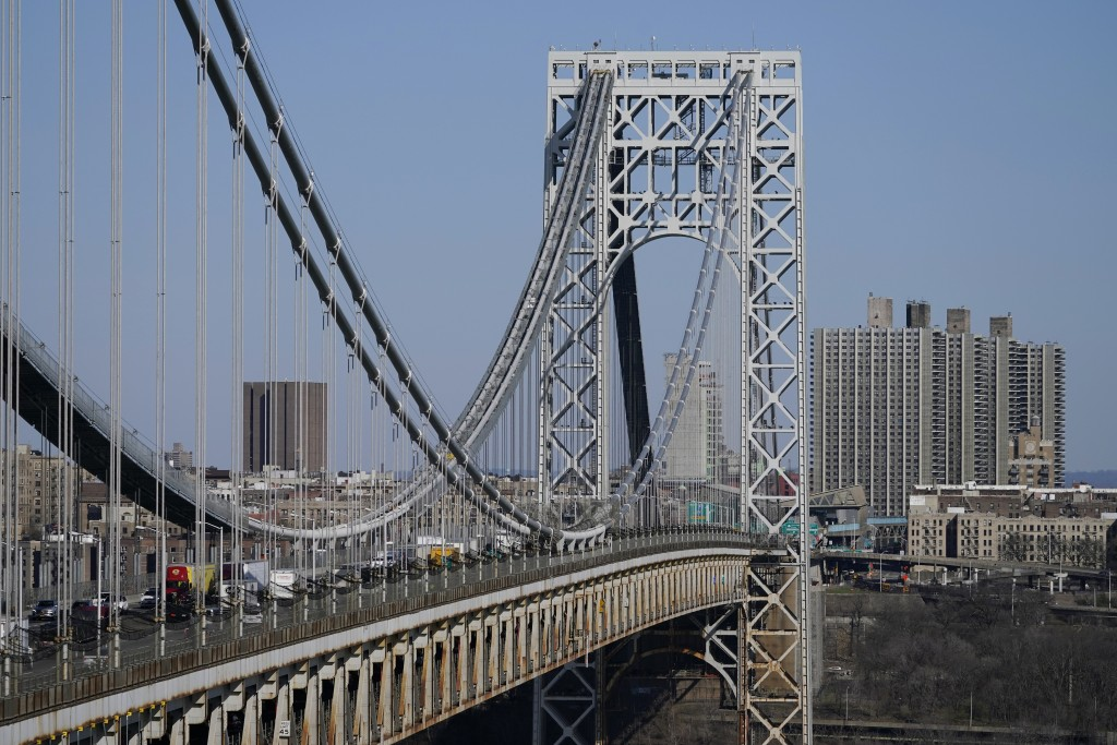 Traffic moves over the George Washington Bridge as seen from Fort Lee, N.J., Tuesday, April 6, 2021. President Joe Biden is setting about convincing A...