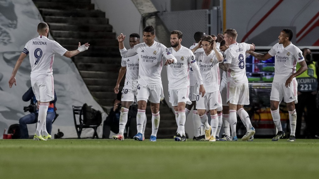 Real Madrid players celebrate their team second goal during the Champions League quarterfinal first leg, soccer match between Real Madrid and Liverpoo...