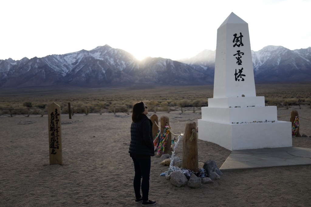FILE - In this Feb. 17, 2020, file photo Lori Matsumura visits the cemetery at the Manzanar National Historic Site near Independence, Calif. The aucti...