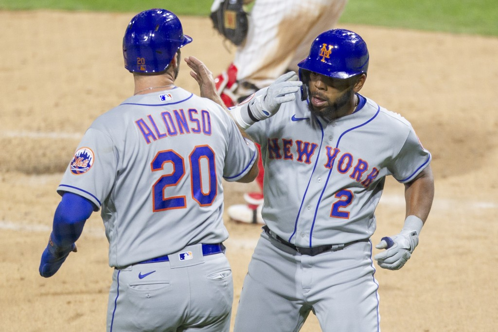 New York Mets Dominic Smith (2) celebrates with Pete Alonso (20) after hitting a two run homer during the fourth inning of a baseball game against the...