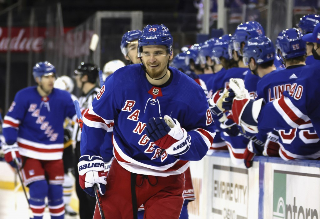 New York Rangers' Pavel Buchnevich (89) smiles after his goal against against the Pittsburgh Penguins during the third period of an NHL hockey game Tu...
