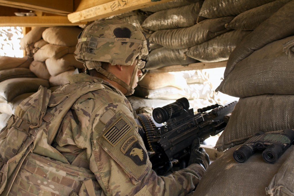 FILE - In this Sept. 8, 2016 file photo, a U.S. Army soldier guards a position at Camp Swift, northern Iraq. Iraq's prime minister asked the Iranian l...