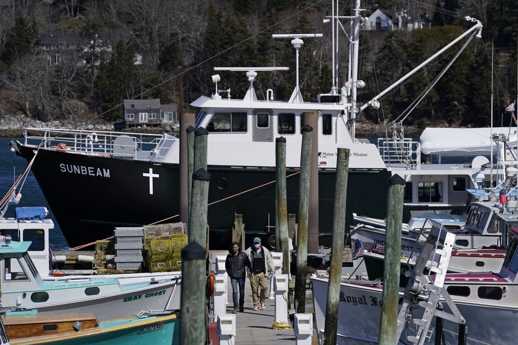 Marc Nighman and Jonathan Partin leave the Sunbeam after receiving a COVID-19 vaccination, Friday, March 19, 2021, in Northeast Harbor, Maine. The 74-...