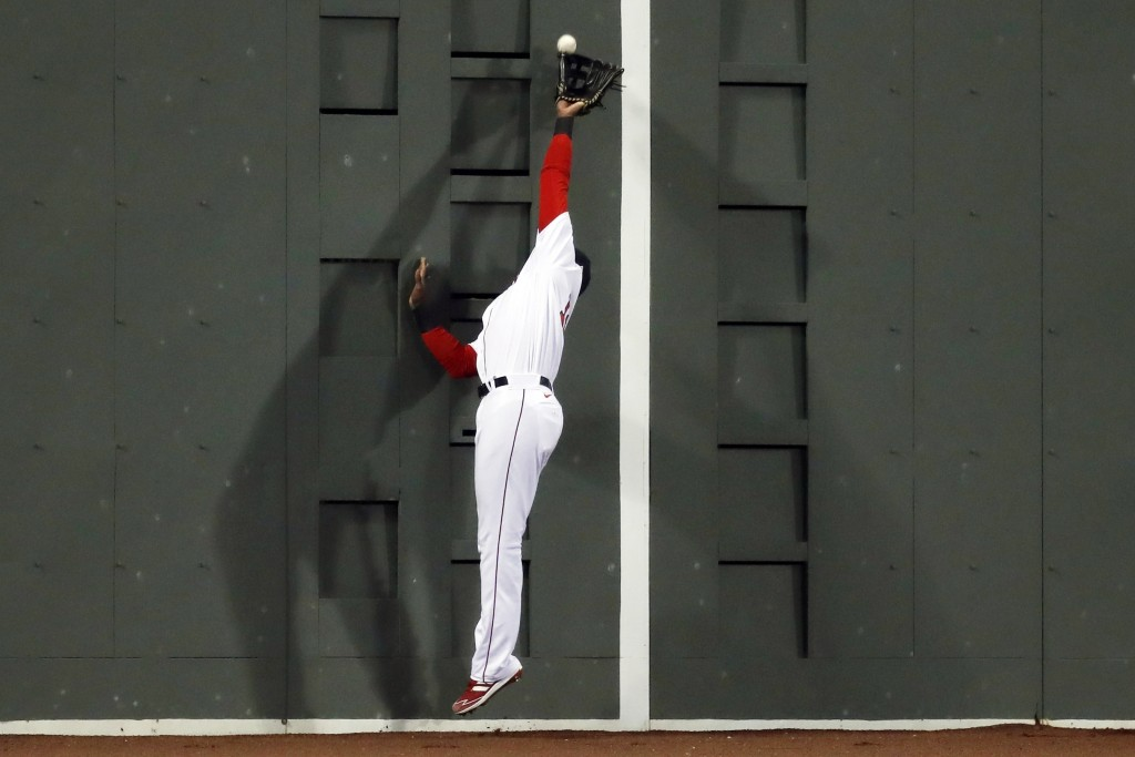 Boston Red Sox's Franchy Cordero makes the catch on a fly ball by Tampa Bay Rays' Manuel Margot during the seventh inning of a baseball game Tuesday, ...