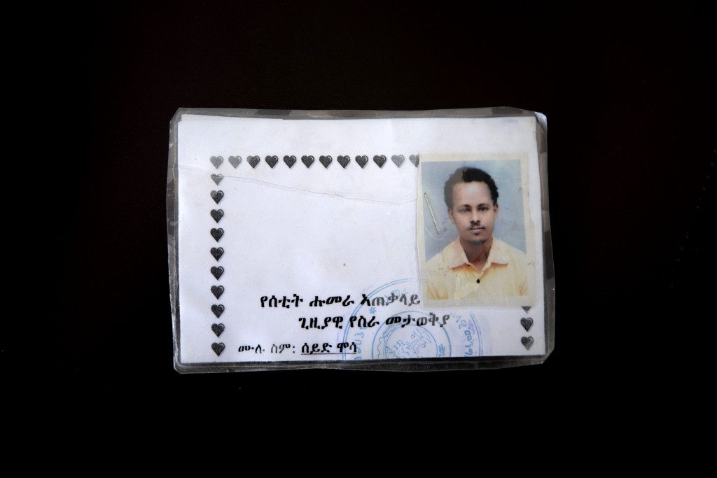 This March 17, 2021 photo shows a new ID card issued by Amhara authorities to Seid Mussa Omar, a 29-year-old Tigrayan nurse from Humera, who fled to H...