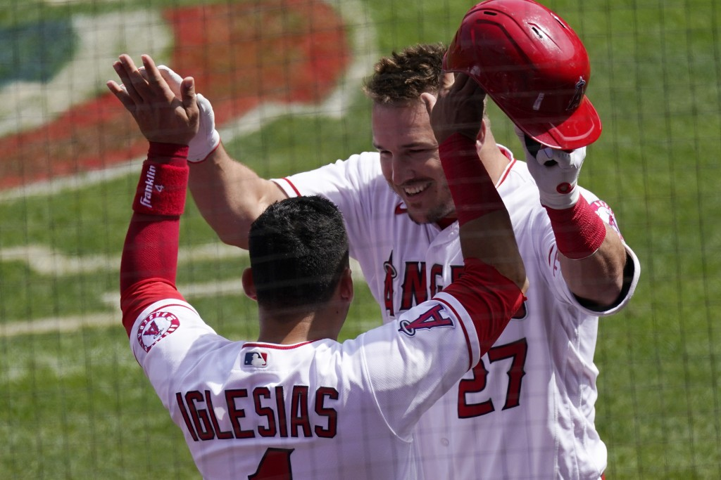 Los Angeles Angels' Mike Trout, right, is congratulated by Jose Iglesias after hitting a two-run home run during the first inning of a baseball game a...
