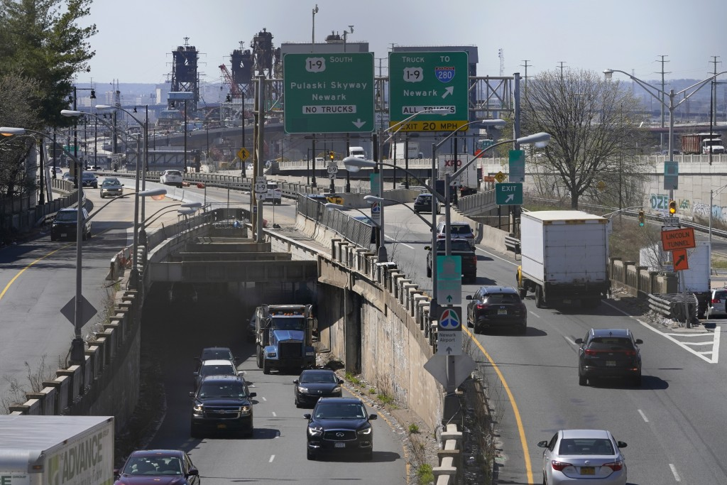 Cars maneuver through tangle of expressways in Jersey City, N.J., Tuesday, April 6, 2021. President Joe Biden is setting about convincing America it n...