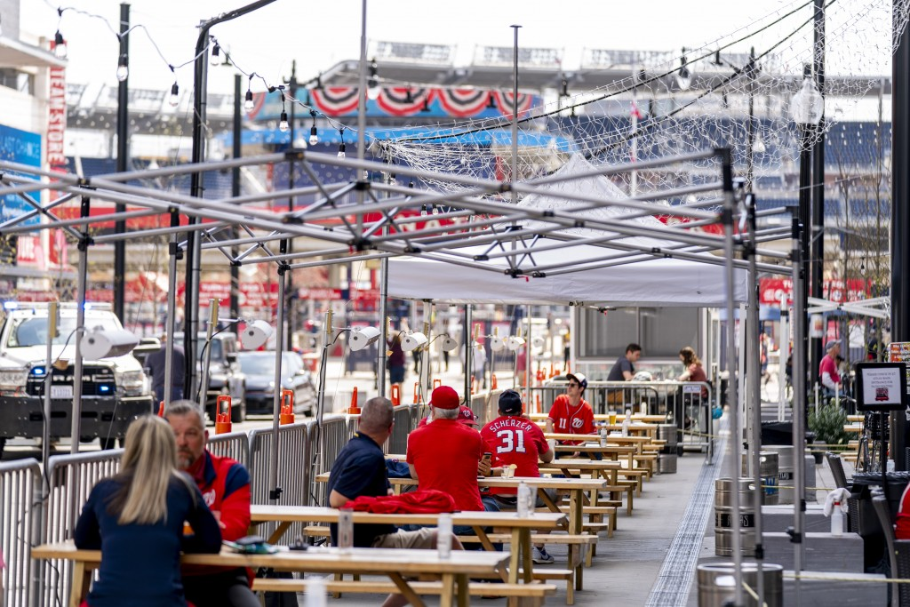 A few fans sit at outdoor bars near the centerfield gate before the Washington Nationals play the Atlanta Braves in their opening day baseball game at...
