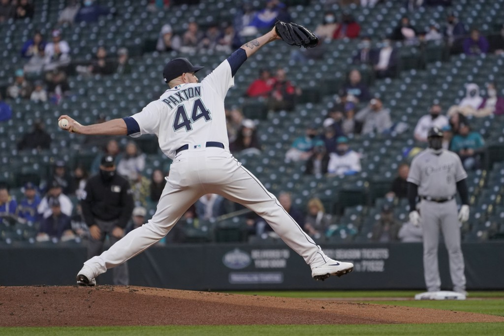 Seattle Mariners starting pitcher James Paxton throws to a Chicago White Sox batter during the first inning of a baseball game Tuesday, April 6, 2021,...