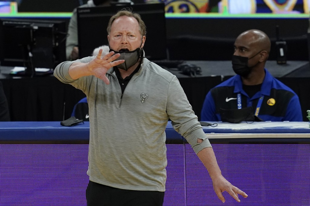Milwaukee Bucks head coach Mike Budenholzer gestures during the first half of his team's NBA basketball game against the Golden State Warriors in San ...