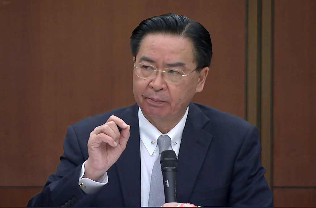 Taiwanese Foreign Minister Joseph Wu speaks during a briefing Wednesday, April 7, 2021, in Taipei, Taiwan. Wu said that China's attempts at conciliati...