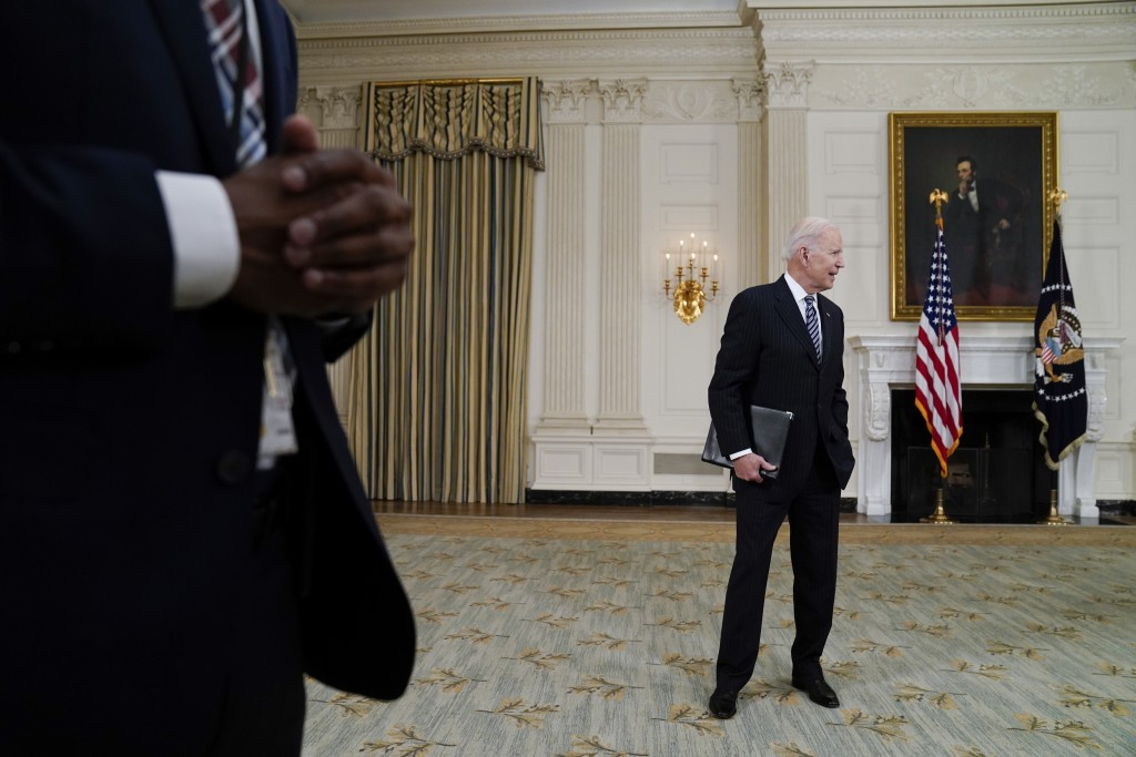 President Joe Biden leaves after speaking about vaccinations, in the State Dining Room of the White House, Tuesday, April 6, 2021, in Washington. (AP ...