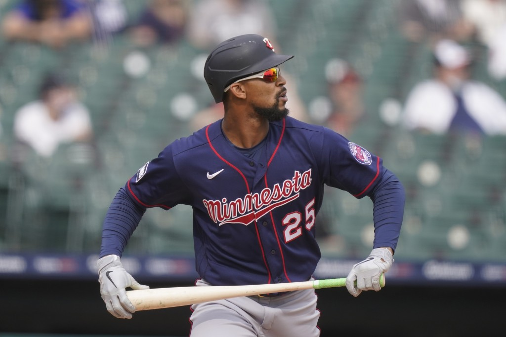 Minnesota Twins' Byron Buxton watches his solo home run during the eighth inning of a baseball game against the Detroit Tigers, Tuesday, April 6, 2021...