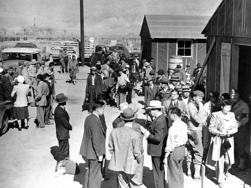 FILE - This March 23, 1942, photo shows the first arrivals at the Japanese evacuee community established in Owens Valley in Manzanar, Calif. The aucti...