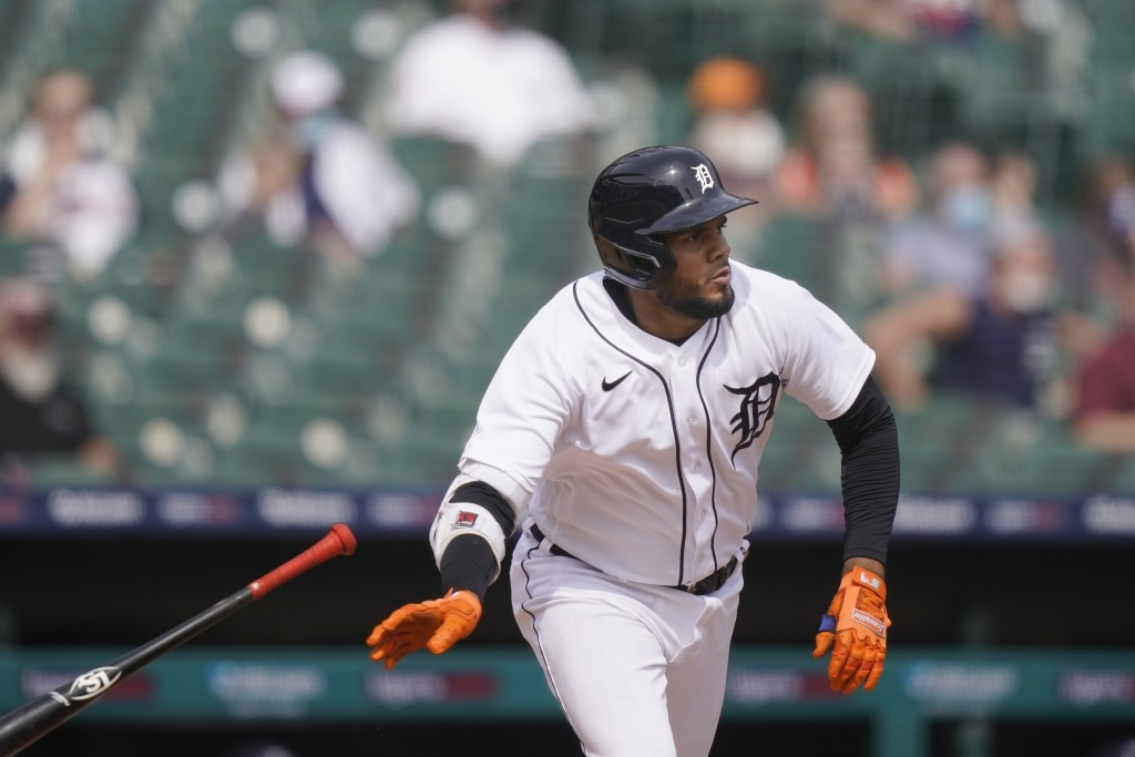 Detroit Tigers' Jeimer Candelario watches his run-scoring double during the fifth inning of a baseball game against the Minnesota Twins, Tuesday, Apri...