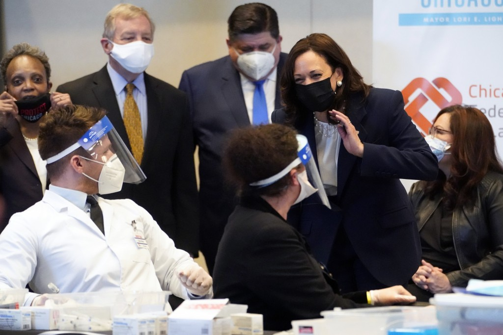 Vice President Kamala Harris speaks during visit to a COVID-19 vaccination site Tuesday, April 6, 2021, in Chicago. Listening are Chicago Mayor Lori L...