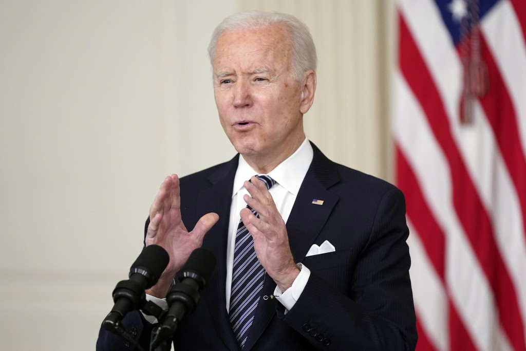 FILE - In this March 25, 2021, file photo, President Joe Biden speaks about the COVID-19 relief package in the State Dining Room of the White House in...