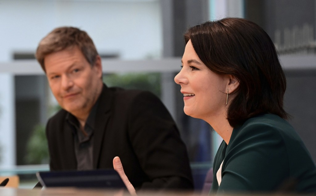 FILE - In this Monday, March 15, 2021 file photo the leaders of Germany's Green party Annalena Baerbock, right, and Robert Habeck attend a press confe...