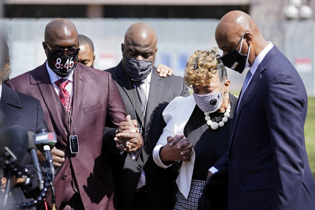 Philonise Floyd, left, the brother of George Floyd and other family members along with Gwen Carr, the mother of Eric Garner, take part in a prayer vig...