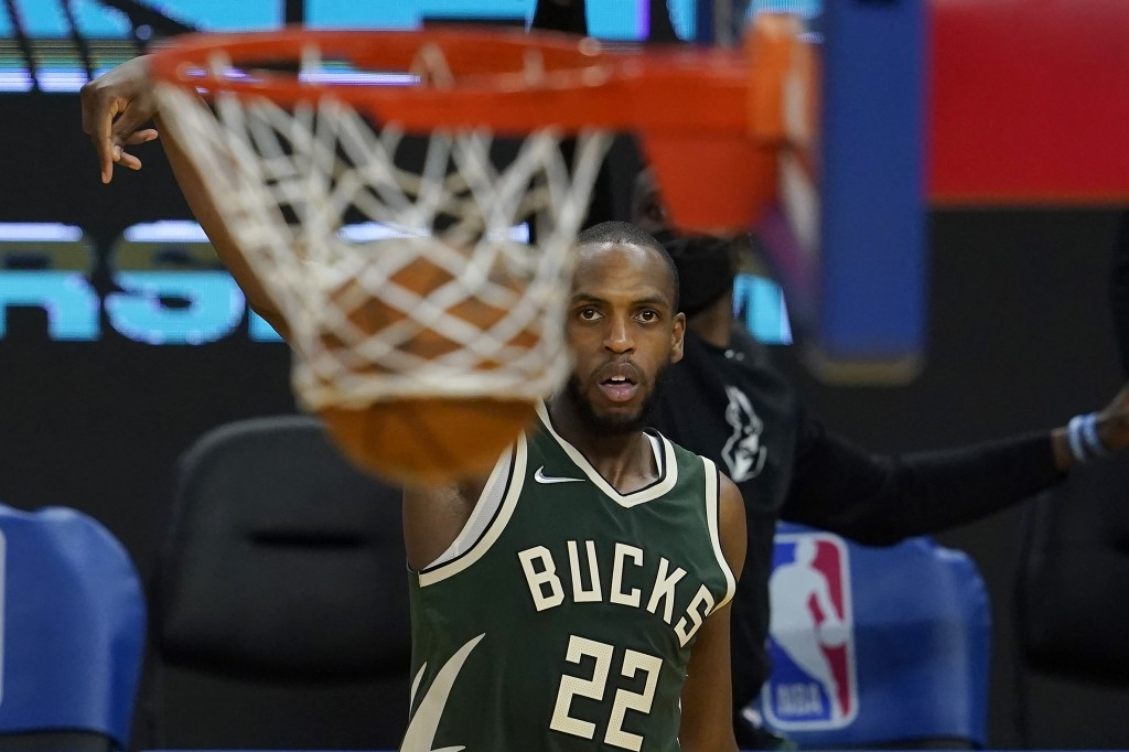 Milwaukee Bucks forward Khris Middleton (22) watches his 3-point basket during the second half of an NBA basketball game against the Golden State Warr...
