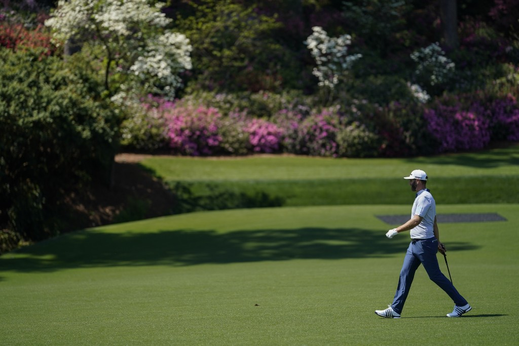 Dustin Johnson walks to the 13th green during a practice round for the Masters golf tournament on Tuesday, April 6, 2021, in Augusta, Ga. (AP Photo/Da...