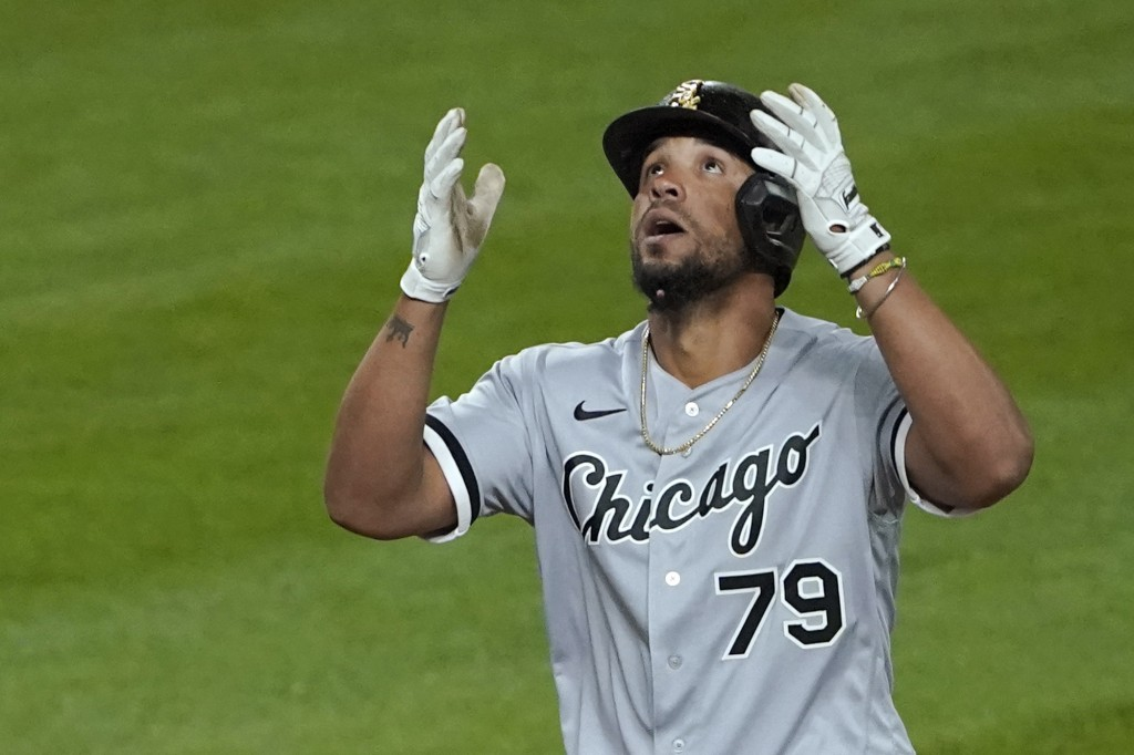 Chicago White Sox's Jose Abreu reacts as he crosses the plate after he hit a grand slam during the eighth inning of a baseball game against the Seattl...