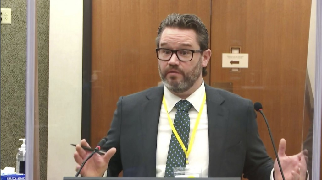 In this image taken from video, defense attorney Eric Nelson questions witness Los Angeles police department Sgt. Jody Stiger, as Hennepin County Judg...