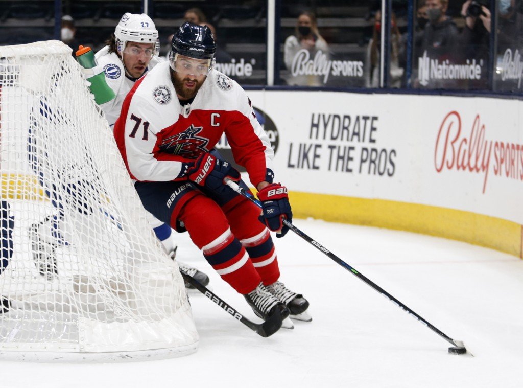 Columbus Blue Jackets forward Nick Foligno, right, controls the puck in front of Tampa Bay Lightning defenseman Ryan McDonagh during the second period...