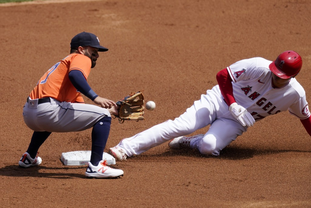 Los Angeles Angels' Shohei Ohtani, right, steals second as Houston Astros second baseman Jose Altuve takes a late throw during the first inning of a b...